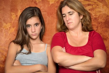 Angry teenage girl and her worried mother