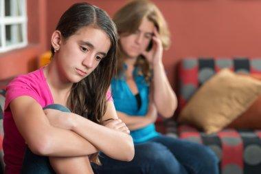 Sad teenage girl and mother