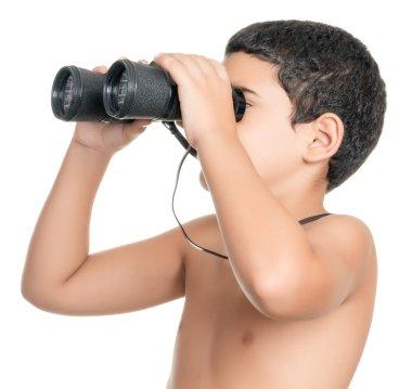 Shirtless hispanic boy looking through binoculars