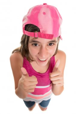 Funny teenage girl wearing a baseball cap doing a thumbs up sign