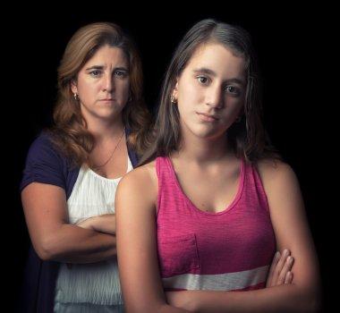 Teenage girl and her mother sad and angry