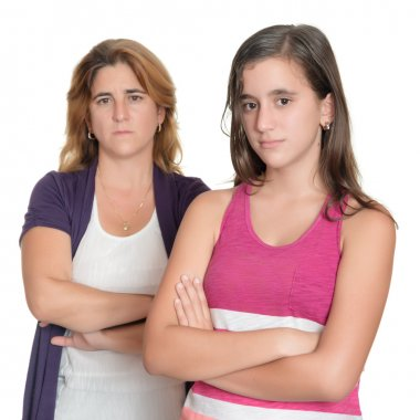 Teenage girl and her sad mother angry at each other