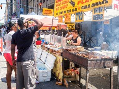 Street kiosk selling ethnic food in New York