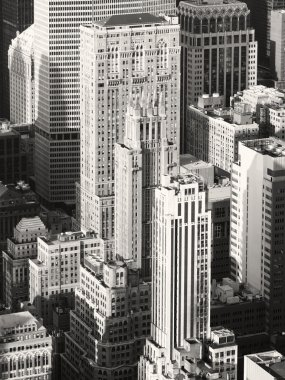 Black and white image of vintage style skyscrapers in midtown Ne