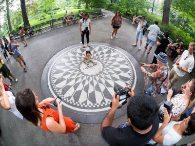 Tourists at Strawberry Fields in Central Park in New York