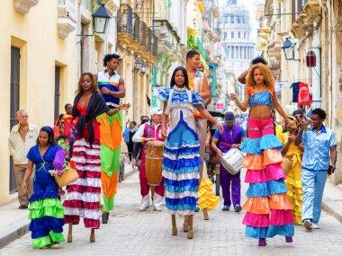 Musicians and dancers on stilts in Old Havana