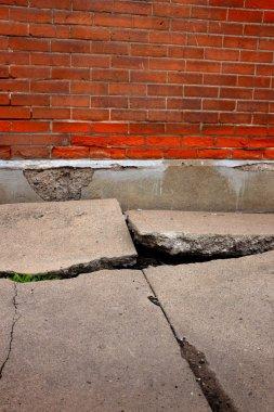 Old Broken Cement Cracked Sidewalk Brick Wall