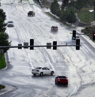 Driving on Road During Rainstorm