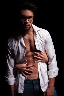 Woman hands embracing hot muscular man