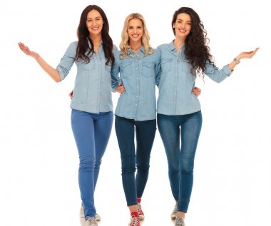 3 happy casual women walking and welcoming you
