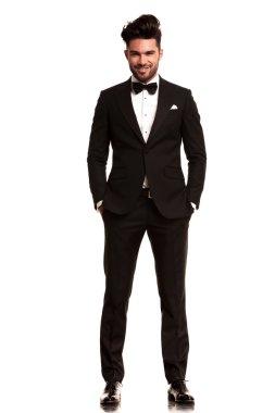 Smiling young man wearing tuxedo