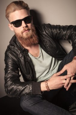 Fashion man with sunglasses and leather jacket