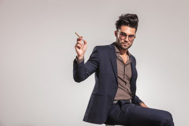 Cool elegant man with cigar ready to smoke