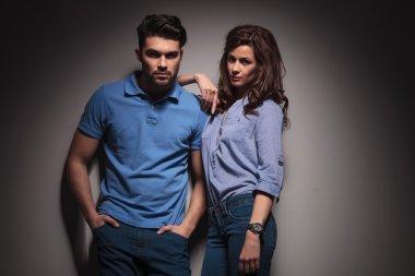 Beautiful fashion woman leaning on her boyfriend