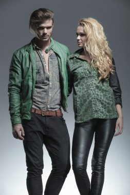 Fashion man and woman holding each other