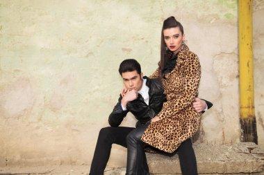 Beautiful fashion woman sitting on her boyfriend lap