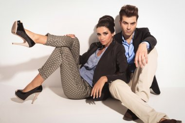 casual man sitting on the floor with his girlfriend