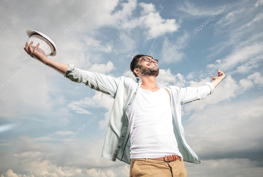 Happy young man looking up to the sky