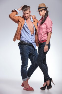 fashion couple posing while looking down