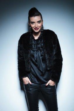 Smiling fashion woman standing