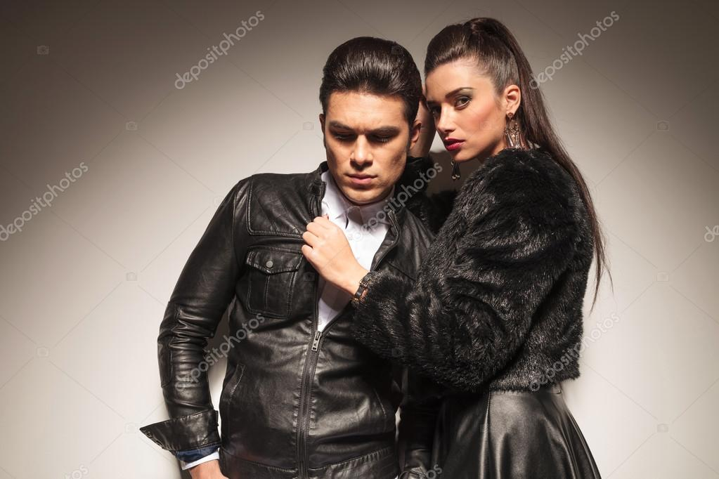 fashion woman pulling her lovers leather jacket