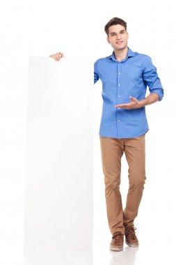 young fashion man presenting a white board