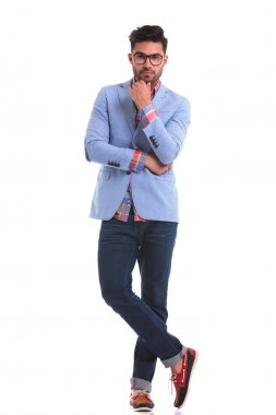 Handsome young man standing on studio background l