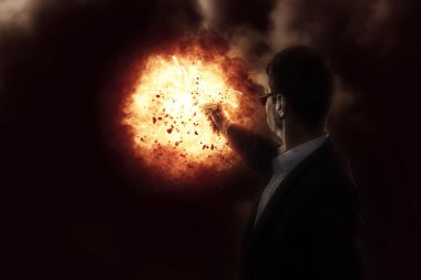 Man with a gun on explosion background