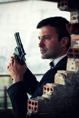 Hitman in tux holding a gun