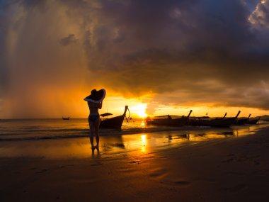 Woman on the beach at sunset on Ao Nanag beach in Krabi