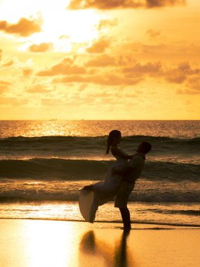 Bride and groom on the beach in Phuket Thailand