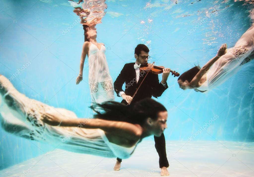 Violinist playing underwater