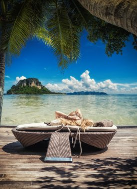 woman relaxing by the sea at tropical resort