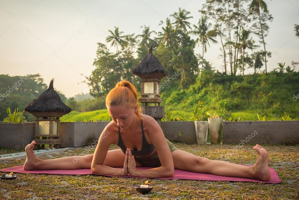 Young woman yoga stretching