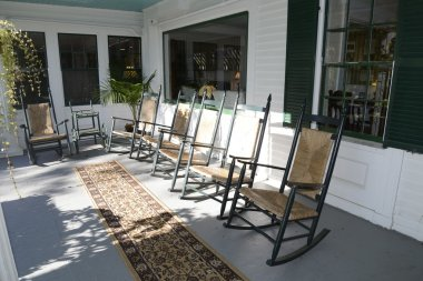 rocking chairs on an outdoor porch