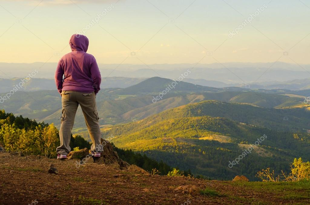 Female climber enjoying the view from the mountain top