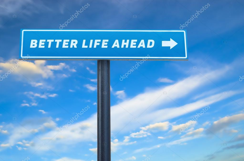 Better life slogan on the street sign against cloudy blue sky
