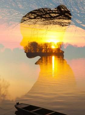 Double exposure - silhouette of girl over landscape showing river and boat at spring sunrise