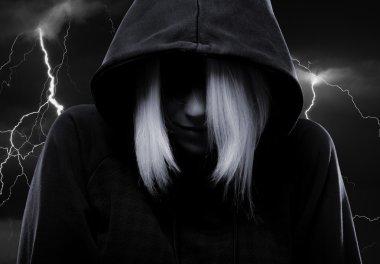 Mystery girl hiding her face under the hood and lightnings