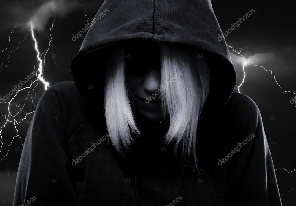 Mystery girl hiding her face under the hood and lightnings