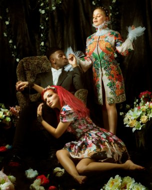 Fashion editorial with two women and one man
