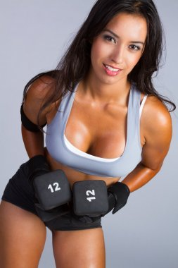 Latin American Woman Lifting Weights