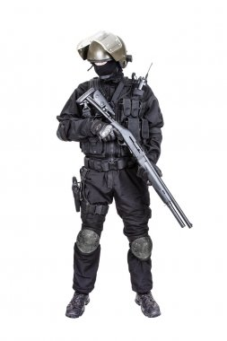 Spec ops soldier in black uniform and face mask with shotgun stock vector