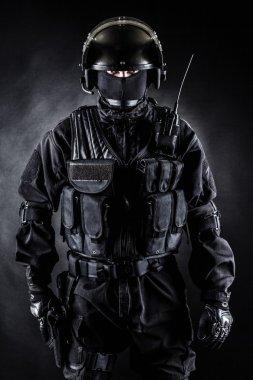 Spec ops soldier in uniform on black background stock vector
