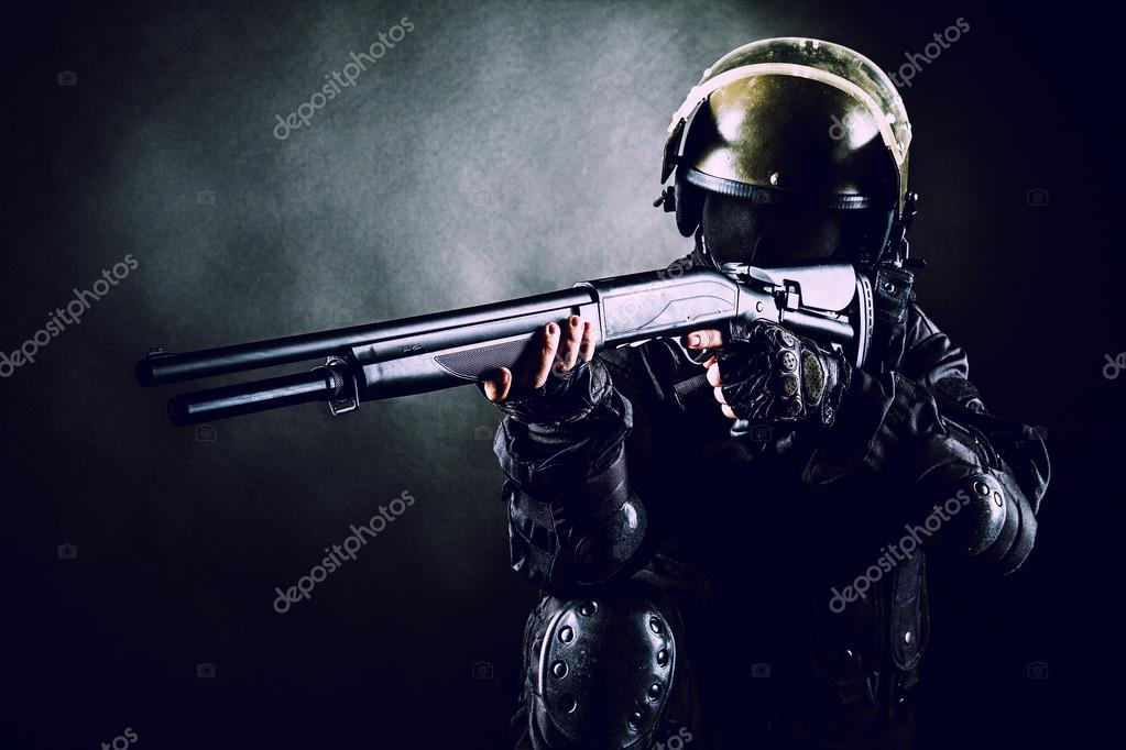Spec ops soldier on black background with shotgun stock vector