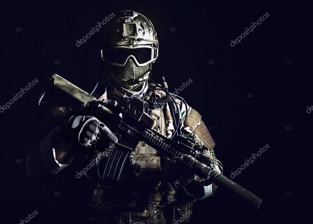 Special forces soldier with rifle on dark background stock vector