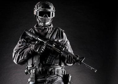 Spec ops police officer SWAT in black uniform and face mask stock vector