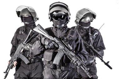 Russian special forces operators in black uniform and bulletproof helmets stock vector