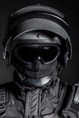 Russian special forces operator in black uniform and bulletproof helmet stock vector