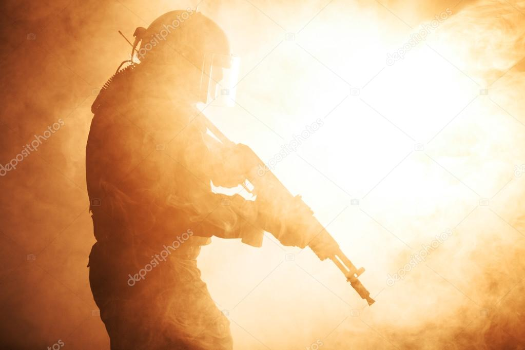 Russian special forces operator in bulletproof helmet in the smoke and fire stock vector